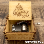 Top view pf the hand engraved wooden musical box that plays happy birthday theme song on turning the crank.
