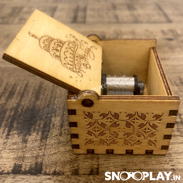 The non battery operated wooden hand engraved musical box that plays happy birthday song.