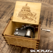 The simple handle cranked music box with exquisite carving, made of solid wood.