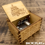 The simple hand cranked music box that has exquisite carving that is made of solid wood.