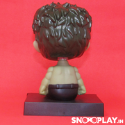 Back view of the incredible Hulk Bobblehead action figure .