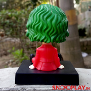 Joker (joaquin phoenix) bobblehead with his green hair and red suit with a secret tray.