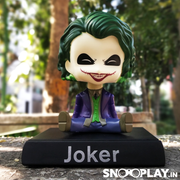"""Why so serious?"", The Joker bobblehead action figure, with a big smiling face. Ideal for room and office decor."