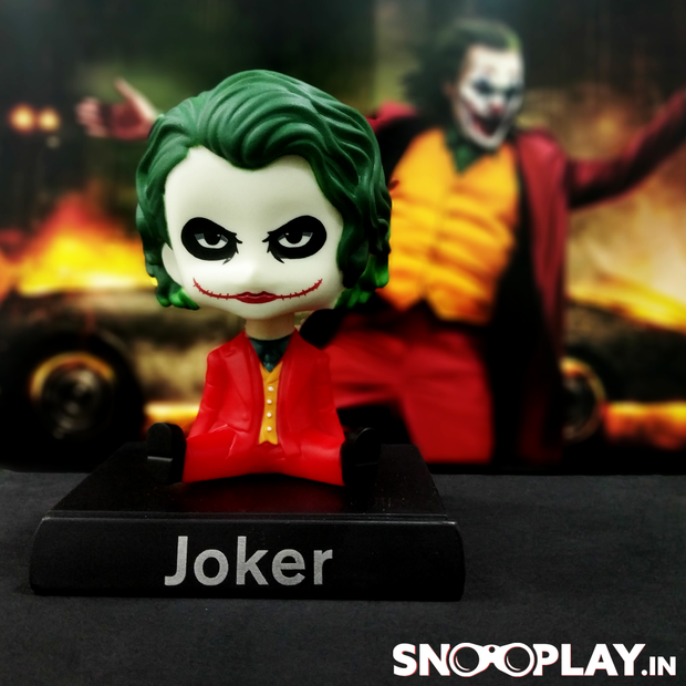 Ideal for gifting to all the joker fans or for your decor, JOKER bobblehead action figure with his detachable phone holder.
