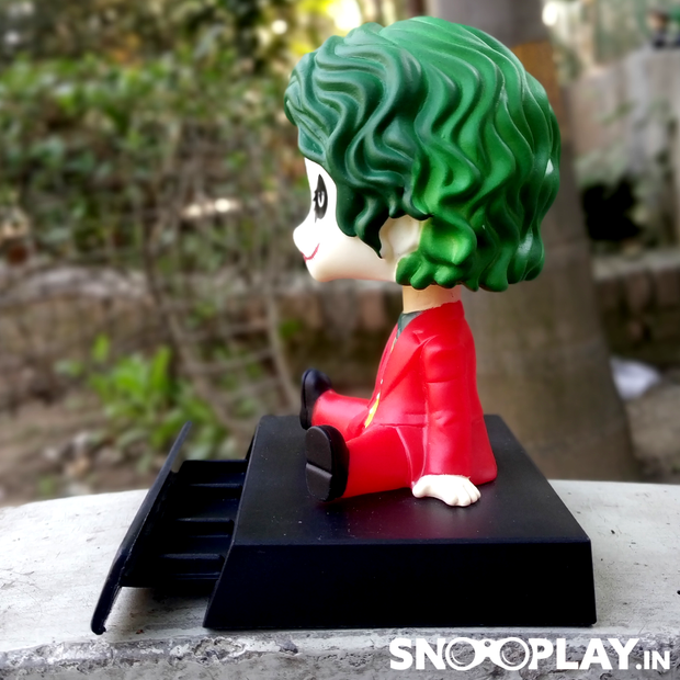 Joker (Joaquin Phoenix) with a bobblehead and also a secret tray , that when pulled out will hold your cellphone/tablet.