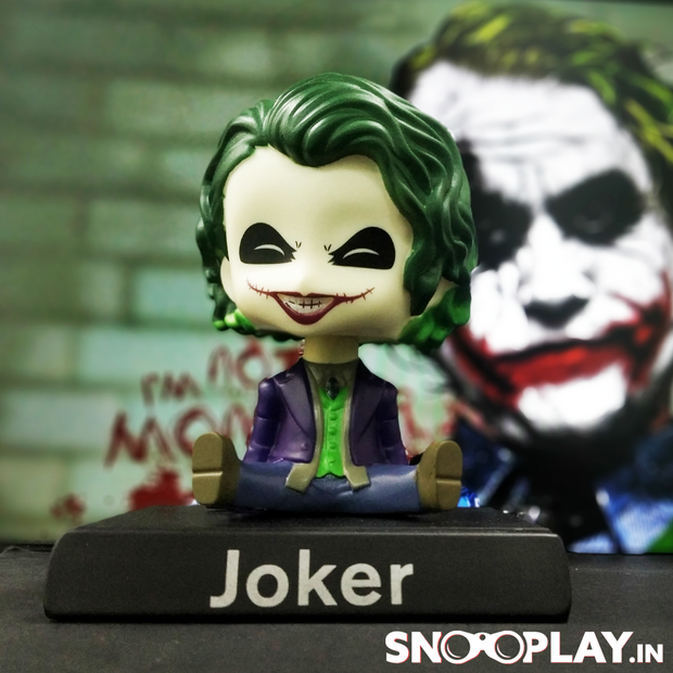 A perfect decor item and gift for all the DC fans, Joker Bobblehead action figure with phone stand,
