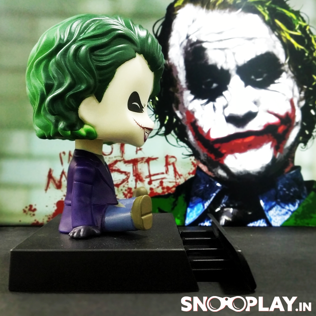 Joker, a fictional character from the movie ,The Dark Knight, of height 2.5 inches, with a mobile stand holder.