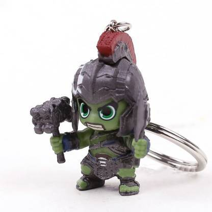 The green skinned, muscular Hulk keychain, ready to fight, with a swagger in his hand.