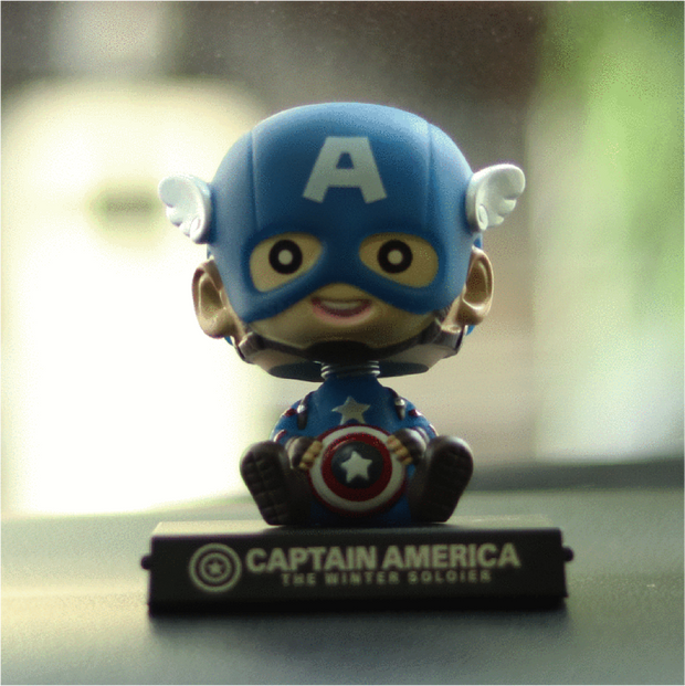Captain America bobblehead action figure placed on a dashboard. A perfect decor item.