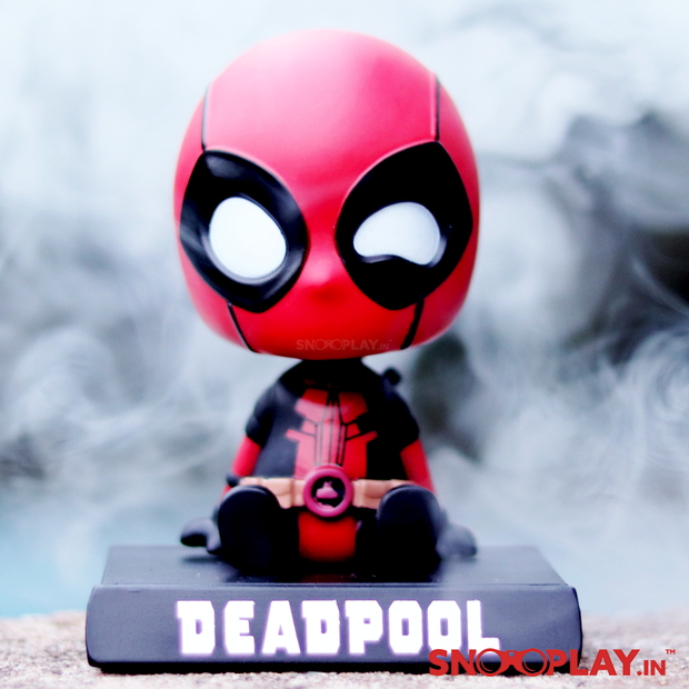 Deadpool bobblehead cum action figure, portable with a secret tray which doubles up as a mobile holder. Perfect for decor purposes.