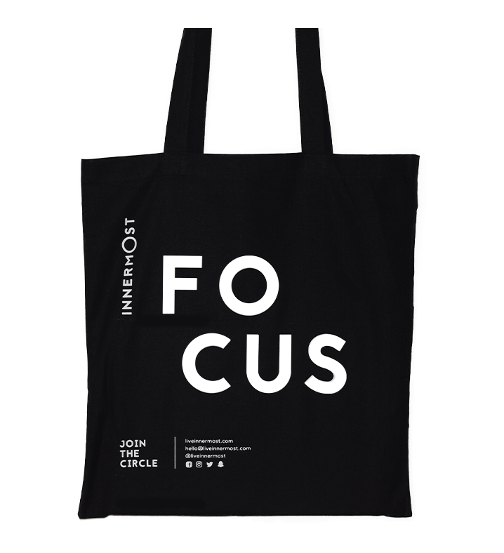 Innermost black cotton tote bag with FOCUS printed on it
