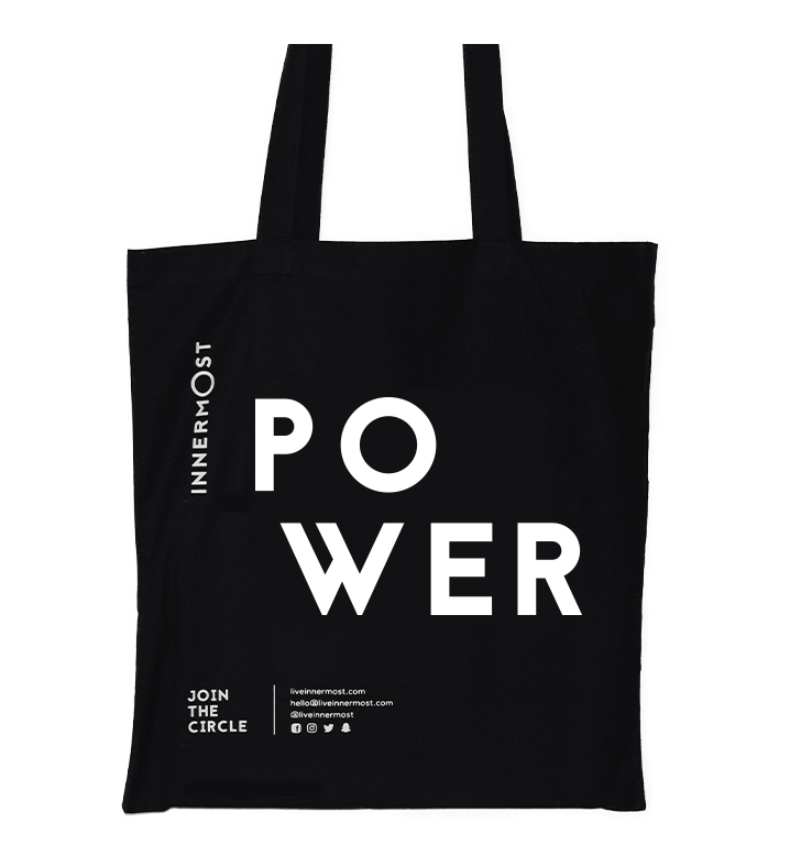 Innermost black cotton tote bag with POWER printed on it