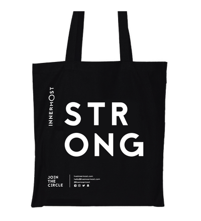 Innermost black cotton tote bag with STRONG printed on it