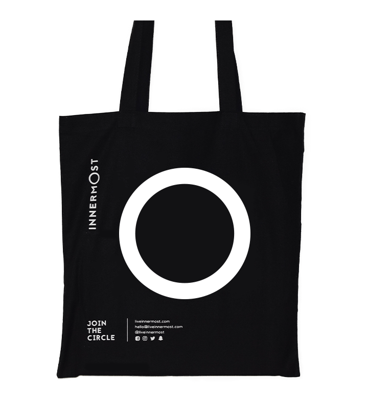 Innermost black cotton tote bag with a large O printed on it