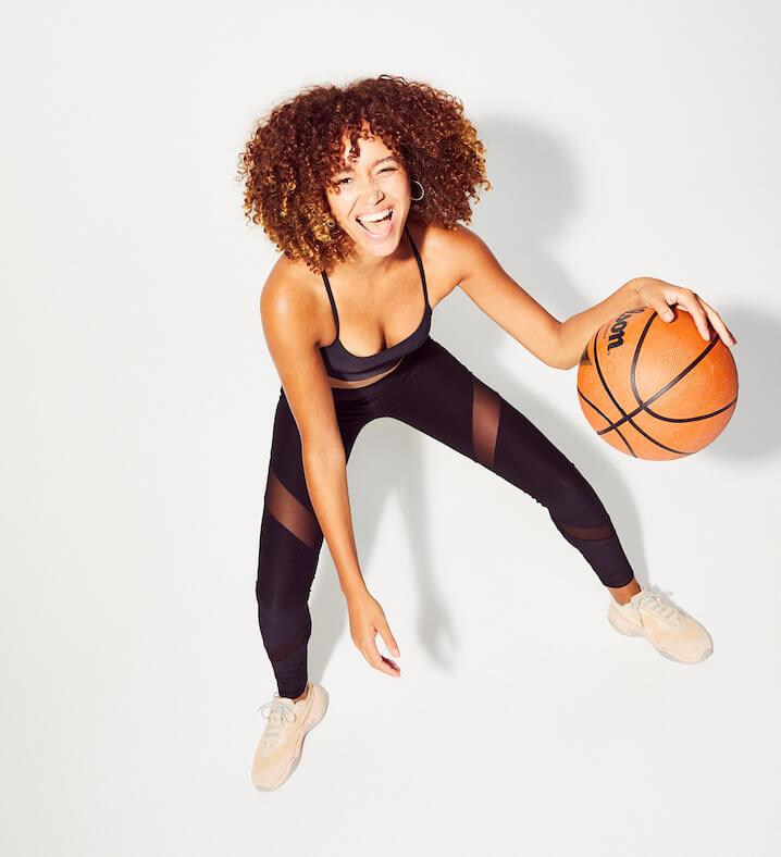 Lulu Stone bouncing a basketball for Innermost