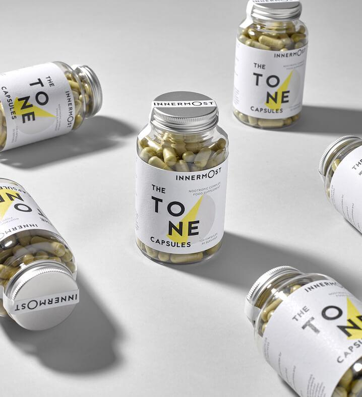 Jars of The Tone Capsules - a nutritional supplement developed by Innermost