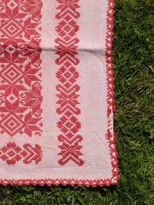 Red and pink embroidered place mat