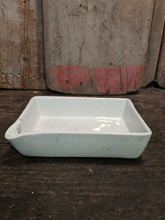 White ceramic dish with spout