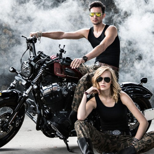 man and woman bikers wearing camo pants
