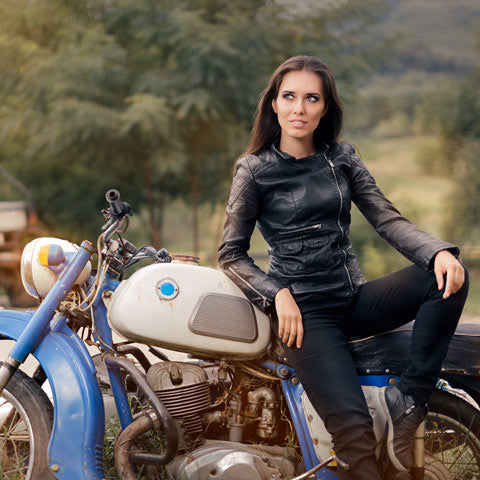 lady on classic bike in denim jeans
