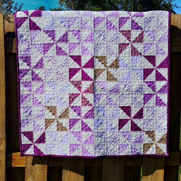 Purple Pinwheels Baby Quilt by Running Stitch Quilts