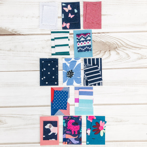 First year memory quilt made with baby onesies by Julie Burton of Running Stitch Quilts