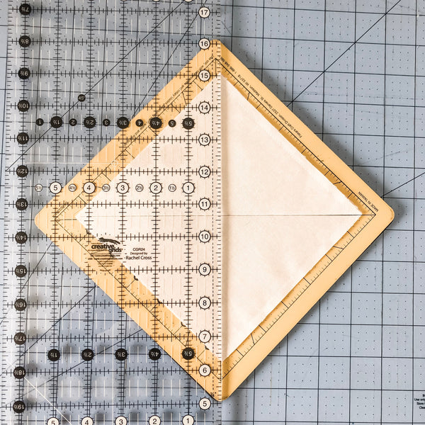 Line up your ruler from corner to corner and make a cut.