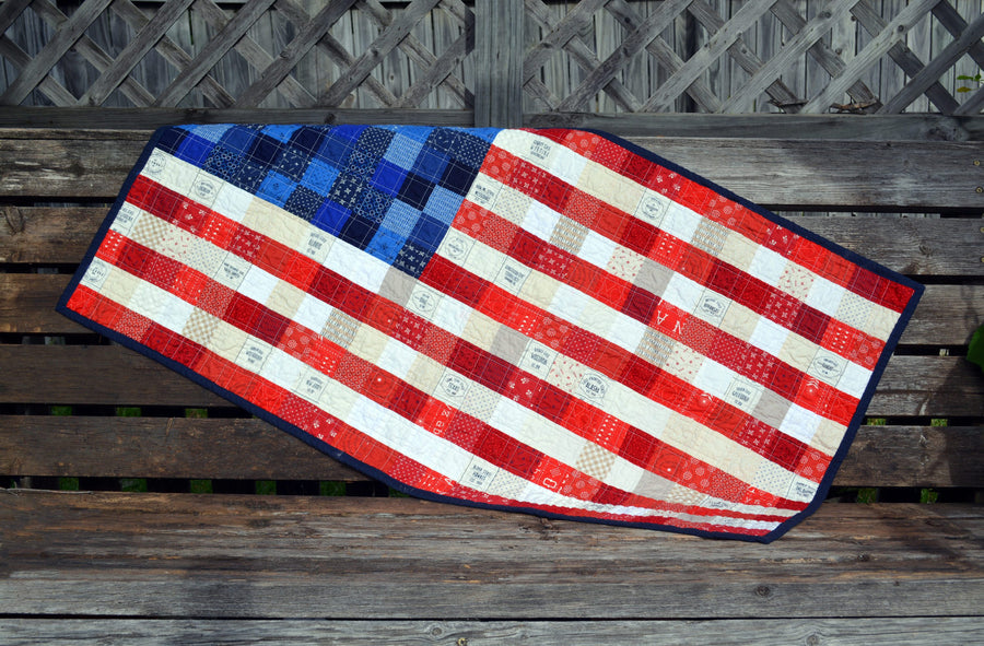 Scrappy, patchwork, American Flag quilted wall hanging