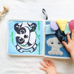 Baby busy book| busy book| baby sensory| baby learning| toddler sensory| toddler learning| Bear and Moo| Bear & Moo| Hamilton, New Zealand| eco-friendly business| small business| cloth nappies| baby using busy book| Baby busy book