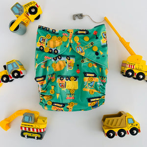 Construction Trucks Cloth Nappy | Bear & Moo | Bear and Moo | Hamilton, New Zealand | cloth nappy | reusable nappies | modern cloth nappies | solid colour | environmentally friendly | save money | good for the environment | alternative to disposables | sustainable living | waste free | Construction Trucks Cloth Nappy