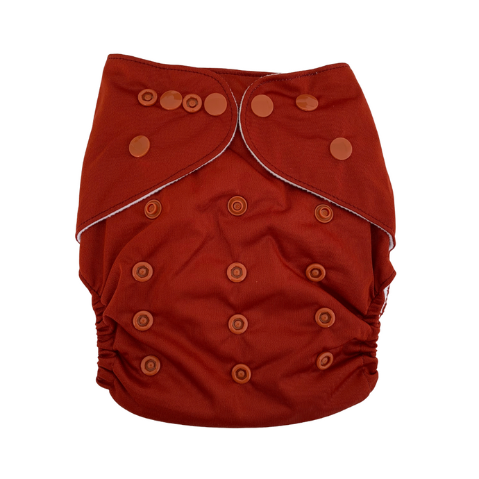 Rust | Bear & Moo | Bear and Moo | Hamilton, New Zealand | bright | cloth nappy | reusable nappies | modern cloth nappies | solid colour | environmentally friendly | save money | bamboo inner | good for the environment | alternative to disposables | sustainable living | waste free | Rust