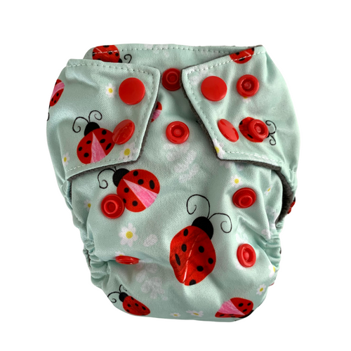 Ladybugs Newborn Cloth Nappy | Bear & Moo | Bear and Moo | Hamilton, New Zealand | cloth nappy | reusable nappies | modern cloth nappies | solid colour | environmentally friendly | save money | good for the environment | alternative to disposables | sustainable living | waste free | Ladybugs Newborn Cloth Nappy