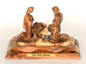 Joseph & Mary Kneeling over Jesus