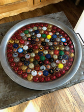 Some of the Best Champagne Caps galore displayed in an 18 inch tray.