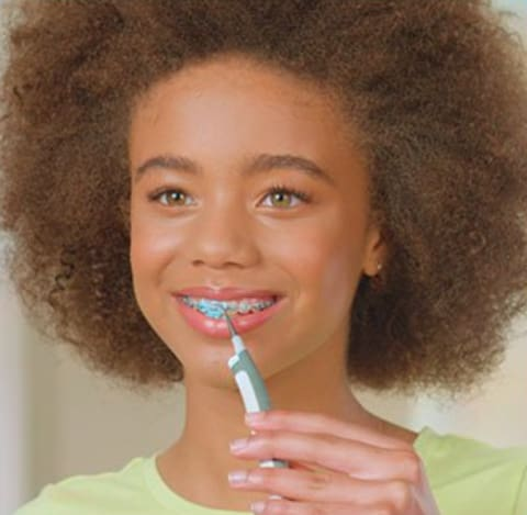 a person brushing the teeth with a toothbrush in the mouth