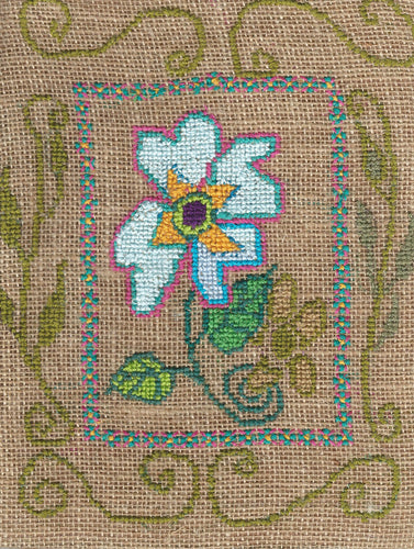 Blue Flower cross stitch on burlap .  A folk art by North Vancouver artist Kathy Poitras