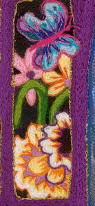 detail of larger work by artist Kathy Poitras. Hand embroidered butterfly with daisies and a daffodil.