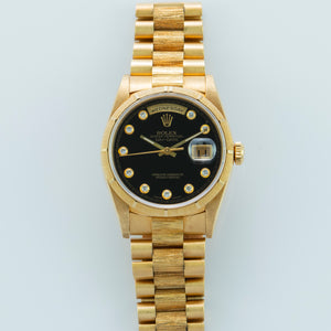 Rolex 18K Yellow Gold Oyster Perpetual Day-Date President Watch with Onyx Serti Dial and Box and Papers | Veralet
