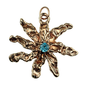 Hand Cast 8 Point Bronze Free Form Star Pendant With Faceted Blue Topaz Stone