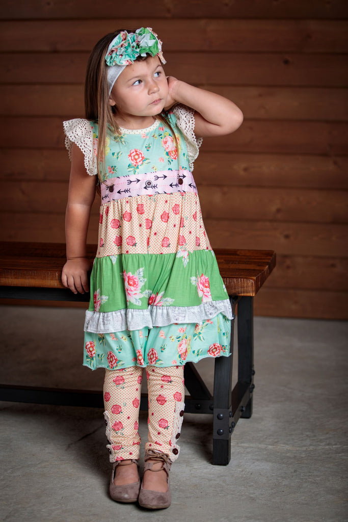 Beautiful 2 piece outfit for girls sizes 2T-7T.  Dress can be worn alone or with leggins. Details of cap sleeves and lace, along with a unique design and soft hues.
