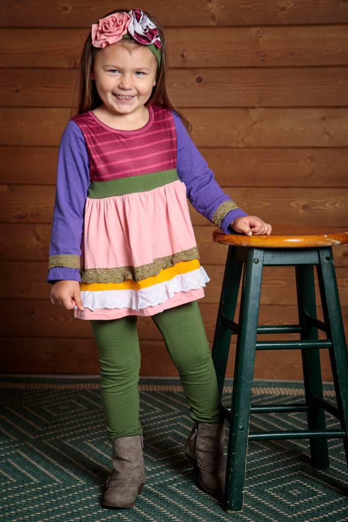 Charming 2 piece girls outfit. Sizes 2T-7T. Green leggings and a pink, purple, and green flowing top. Flowered headband included.