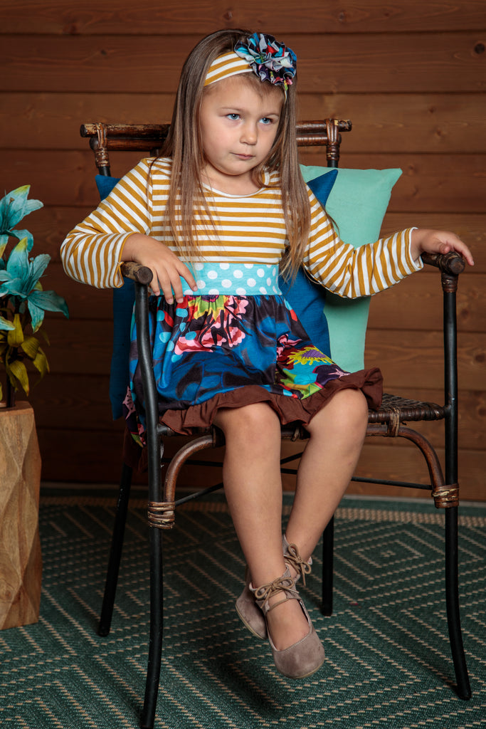 Gorgeous dress with tan stripes and blue floral skirt and a light blue polka dot sash. Sizes 2t-7t.