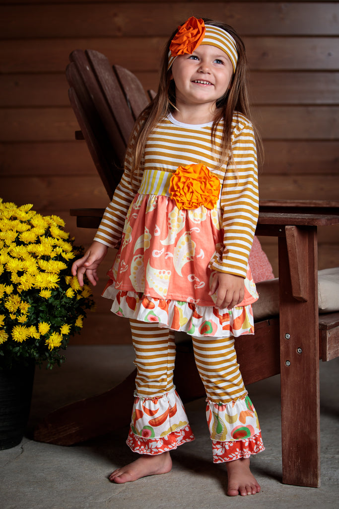 Orange, peach, and tan make up this adorable outfit. Stripes and a paisley design keep this outfit fun. Sizes 2t_7t.