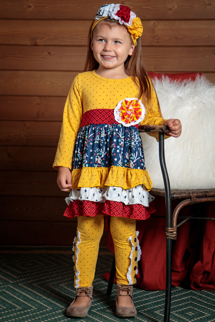Bright, bold and fun 2 piece outfit.  Colors of yellow, red and blue for girls sizes 2t-7t. Headband included.