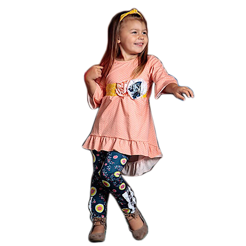 Delightful and stylish 2 piece girls outfit. Sizes 2t-7t. Leggins have button and ruffle detail and the top has flower and polka dots.