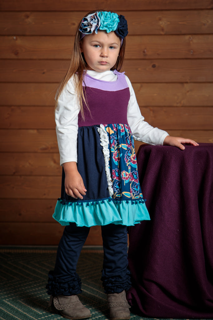 Purple, blue, and navy make up this 2 piece dress and pants outfit. Sizes 2t-7t. Mix and match or wear together.