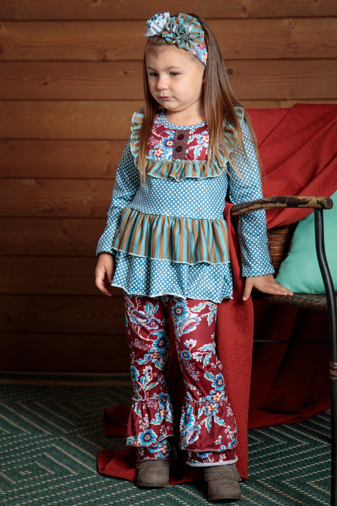 Burgundy and blue make up this top and pants outfit. Fun, 70s inspired flared leg bottoms and flowing top. Sizes 2T-7T.