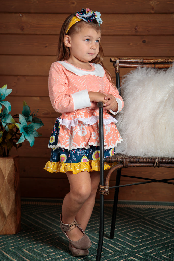 sweet 2 piece top and skirt outfit. so feminine with ruffles and polka dots. Sizes 2T-7T.