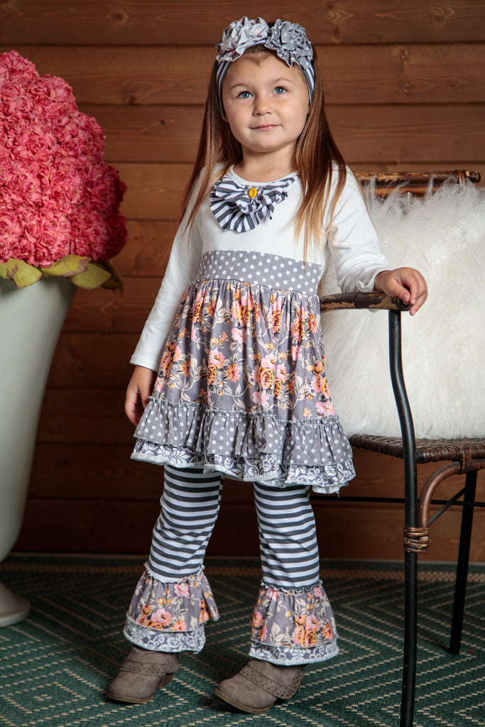 Beautiful long sleeved top with striped ruffled pants. Flowing and elegant design. Sizes 2T-7T.
