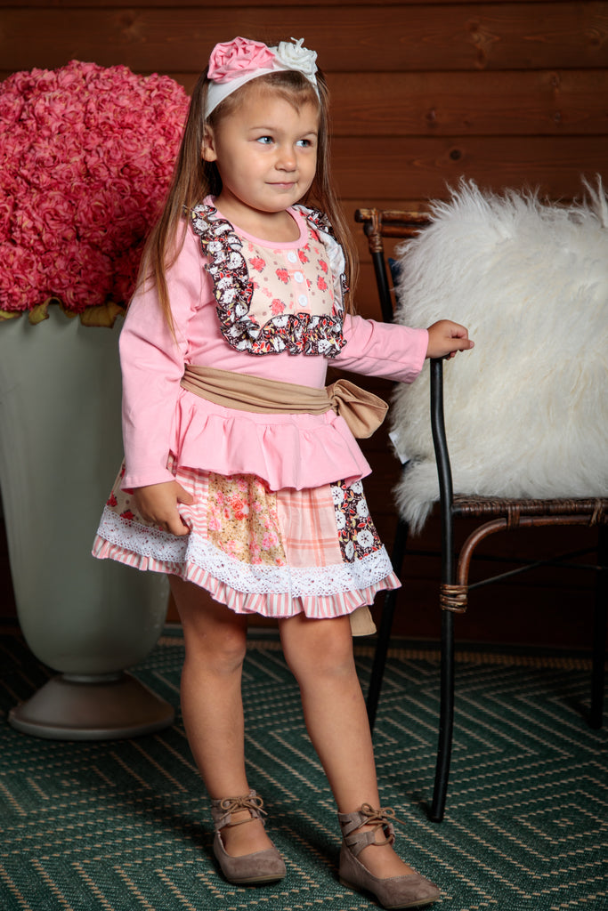 Perfectly detailed top and skirt outfit. Pink with ruffle detail and sash make this outfit so cute. Sizes 2T-7T.